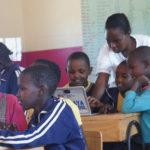 Teacher agness teaching the pupils with the chrome books